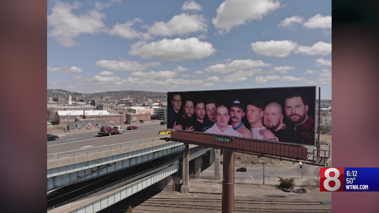 9 friends from Waterbury area place viral 'family photo' on billboard
