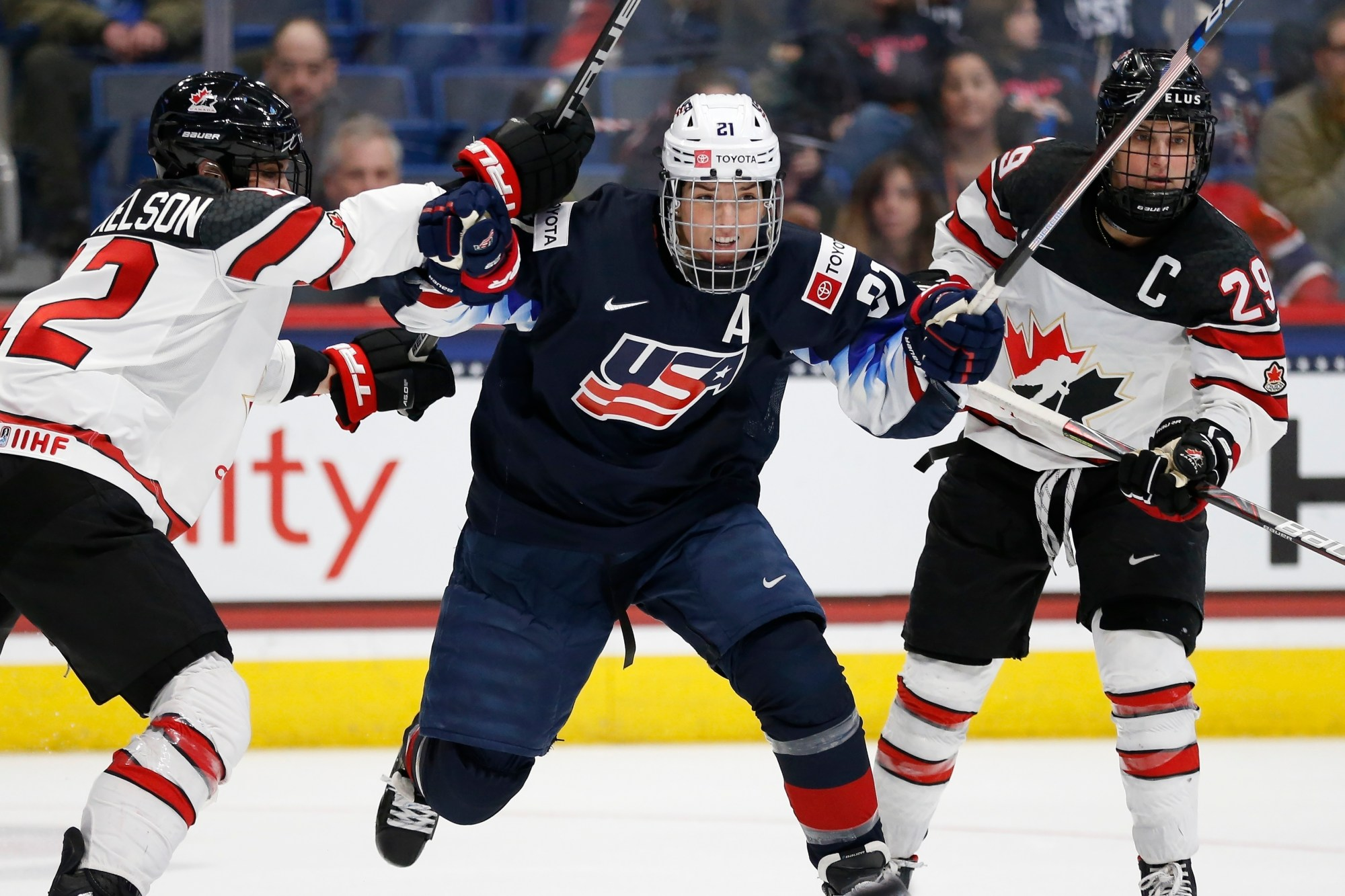 Hilary Knight, Meaghan Mikkelson, Marie-Philip Poulin