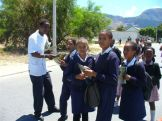 Sandile our Patient Advocate handing out Edward the Elephant Books about Aids to the Westlake children