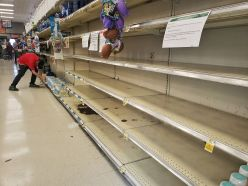 A Warwick ShopRite employee works hard trying to keep up with the high demand of restocking empty water shelves on Sat., Mar. 14. Photo credit: Warwick Valley Dispatch/Lourice Angie