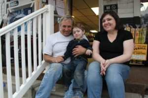 Jarrell family sitting on storefront's stairs