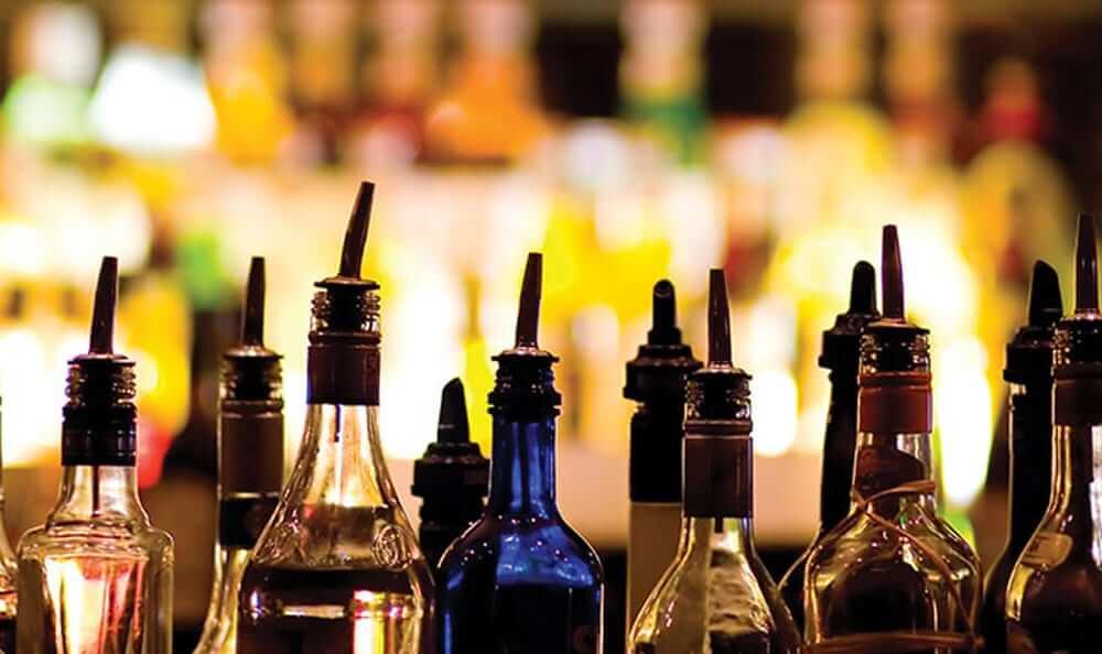 lineup of liquor bottles