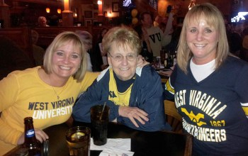 My sister and I are watching a Mountaineer game with mom