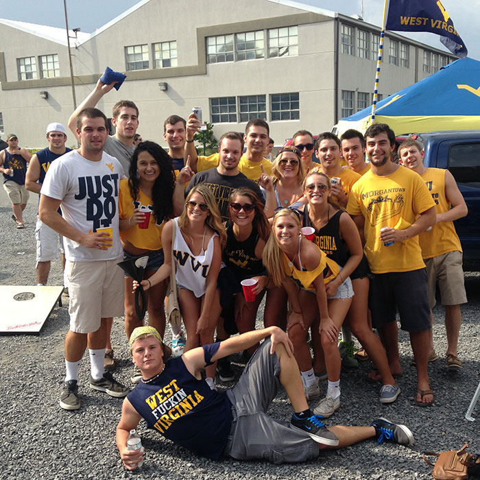 WVU students tailgating in the Gold Lot