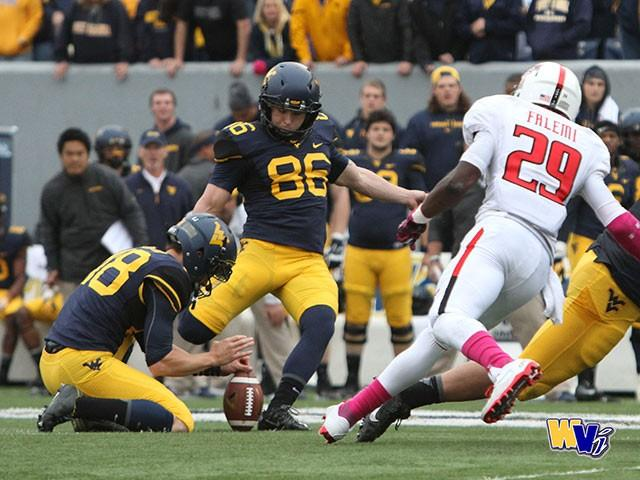 Josh Lambert kicks a 55-yard game-winning field goal against Texas Tech. Photo credit: WV Illustrated