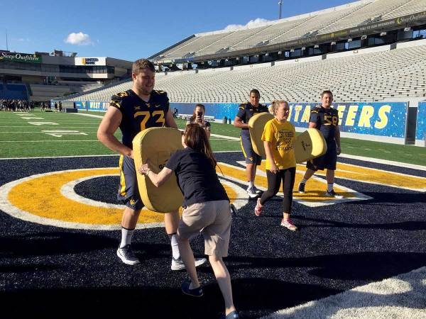 WVU Football Players School The Ladies on Gridiron Basics
