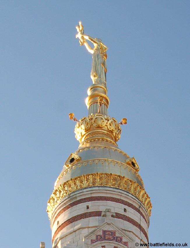 The Golden Virgin on top of Albert Basilica today