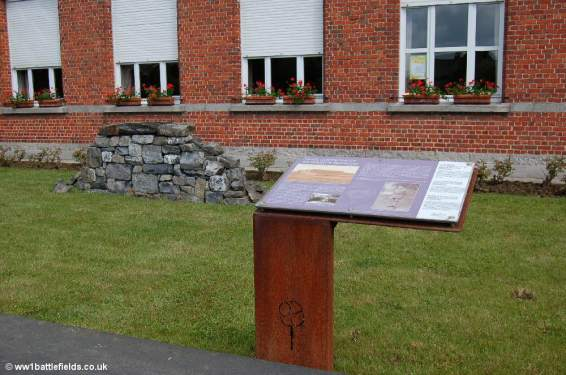 Information board on Major Redmond in front of some stones from the original Locre Hospice