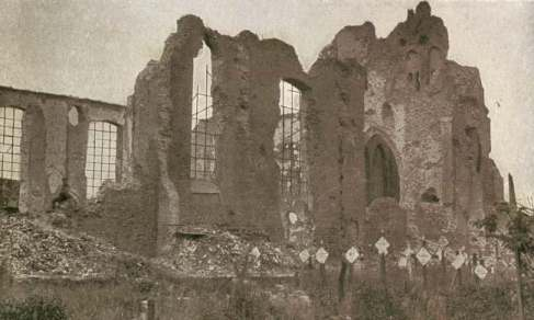 Langemark Church damaged, graves in the foreground