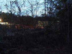 NW from Martin Lane: drill site, berm, fence, structure
