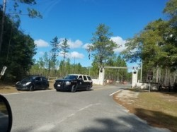 Park Ranger and state trooper cars at closed SRSP gate, 30.3783555, -83.1655342