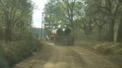 Troy pipe truck on Gary Lane, 30.7652375, -83.4158111