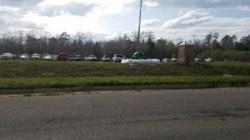 White plastic, green equipment, fire hydrant, porta-pottie, 152256 30.7625581, -83.5529997