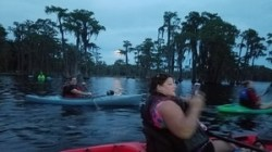 Full moon rising over Banks Lake with paddlers 31.0343318, -83.0979168