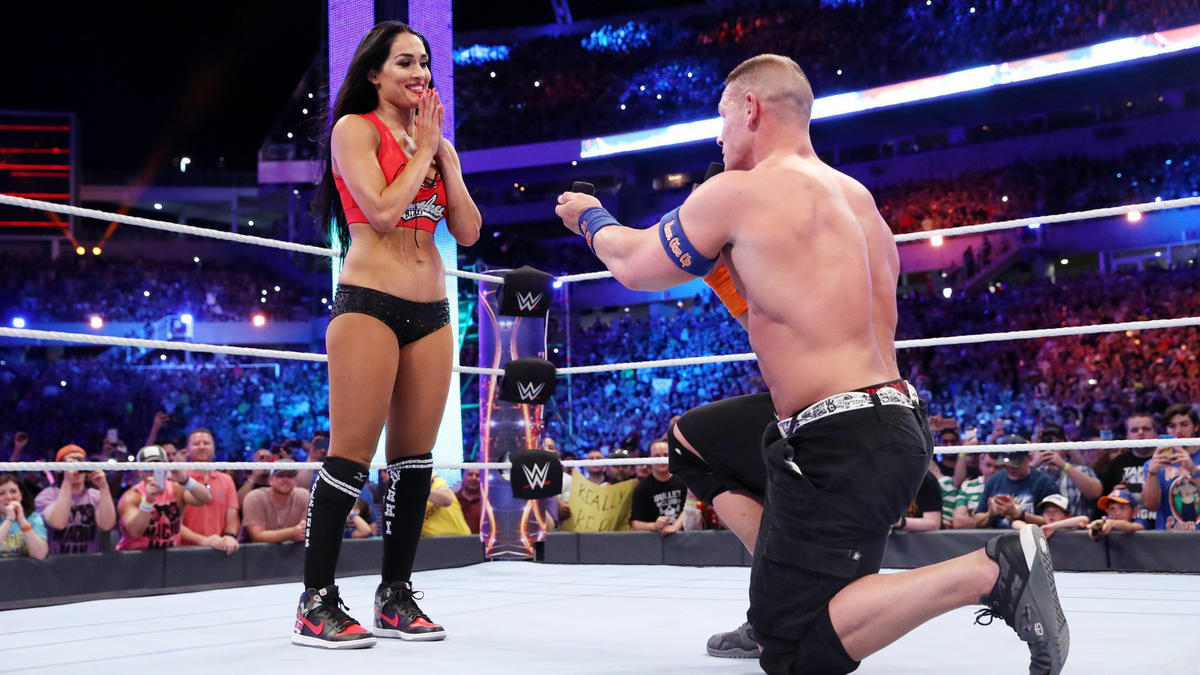 Cena drops to one knee and proposes to Nikki!