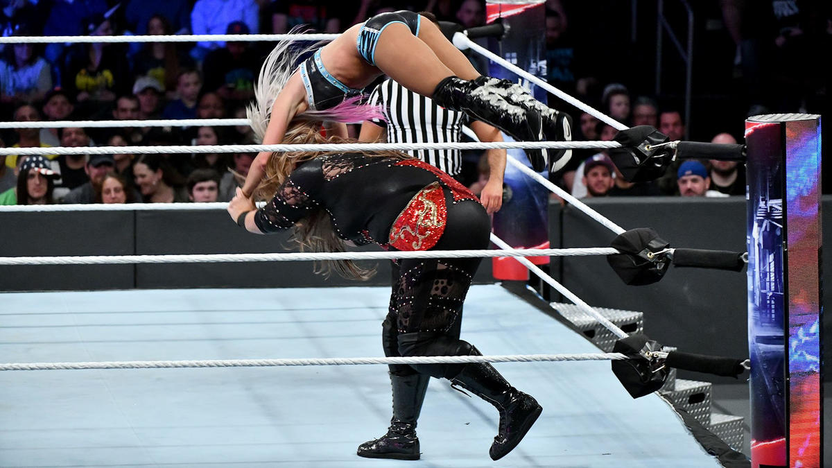 Nia once again hurls Alexa to the mat.
