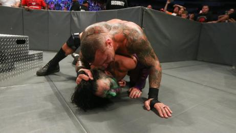 Orton overwhelms his wounded rival.