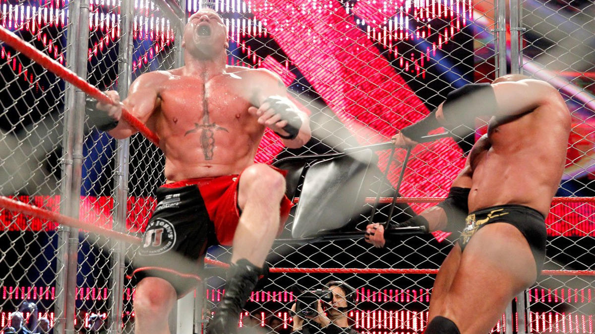 The Game goes to work on Lesnar's injured leg.