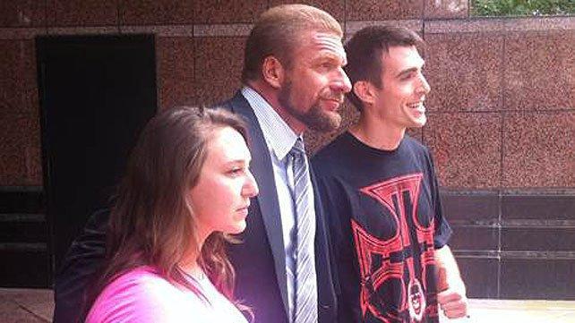 Triple H cuts hair