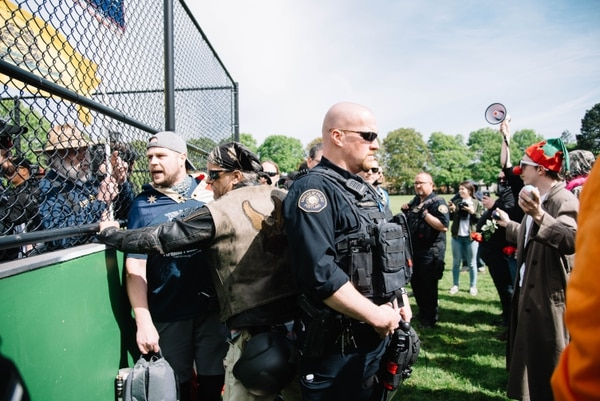 "Jeremy Christian (left, with backpack) at a ""free speech"" rally in Portland last month. (Joe Riedl)"