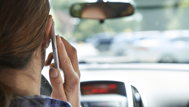 Woman In Car Talking On Mobile Phone Whilst Driving_595979