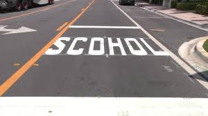 Road crew misspells 'school' on crosswalk_1555749129824.jfif.jpg