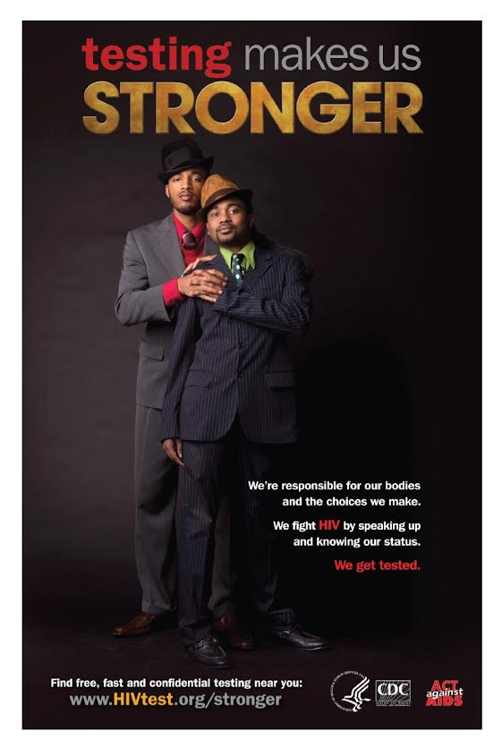 Gay couple dressed in suit and hat. caption talks about the importance of aids testing