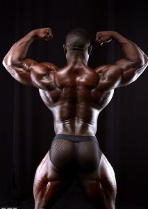 Black male body builder posing with his back to us