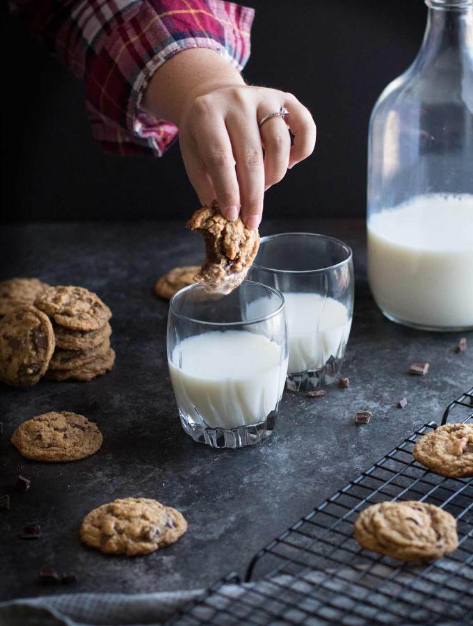 Dunking a paleo chocolate chip cookie in milk