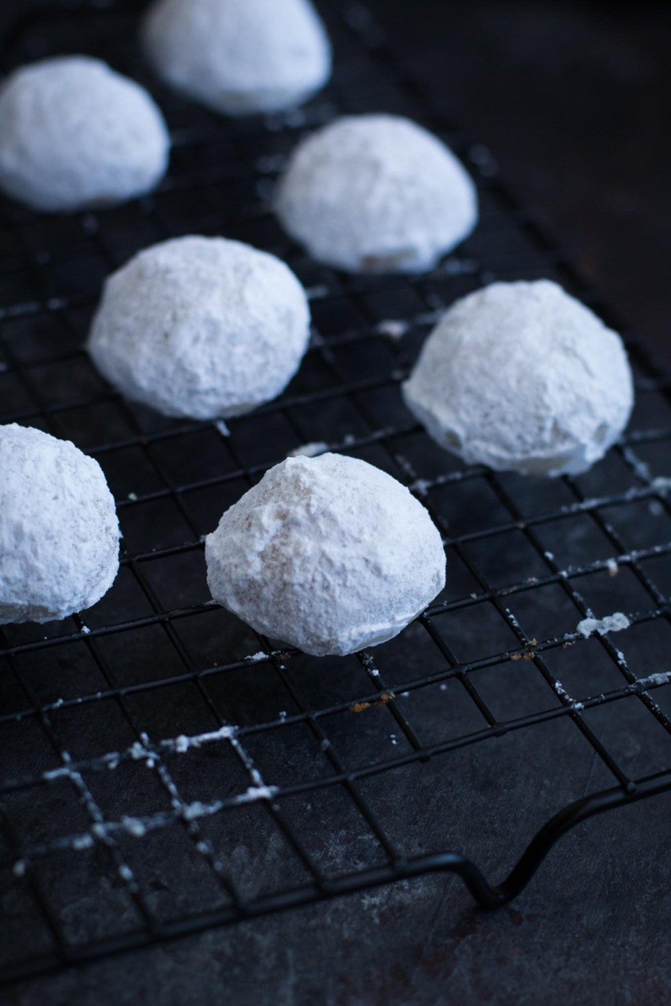 Danish wedding cookies cooling on a cookie rack.