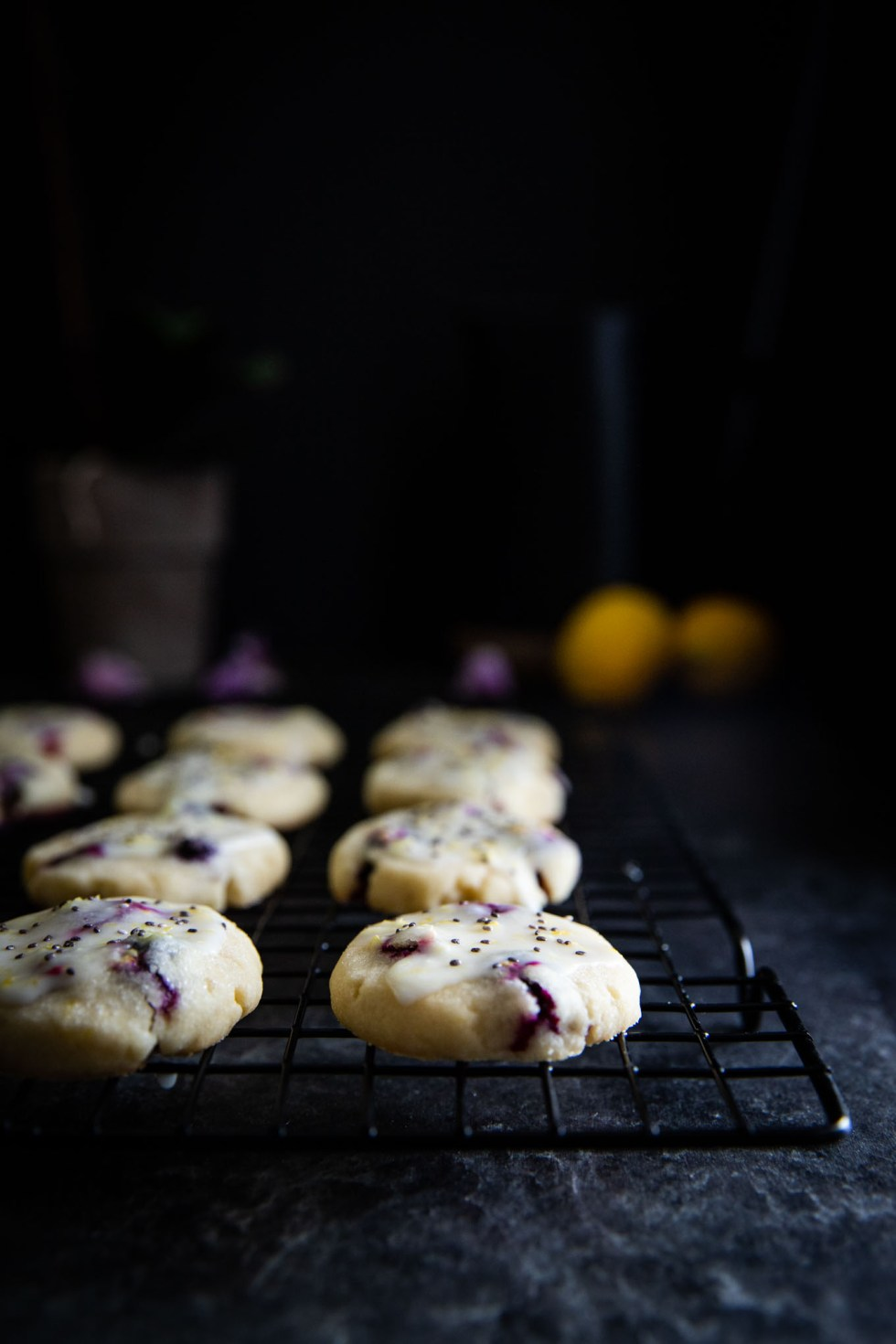 Delicious chia lemon blueberry cookies with bright blueberries, lemon glaze, and chia seeds! These sugar cookies are easy to make and perfect for sharing!