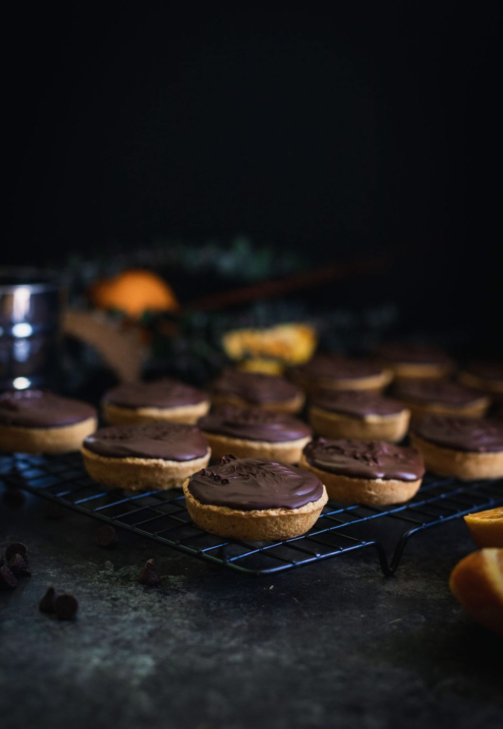 Jaffa cakes cooling on a black metal rack