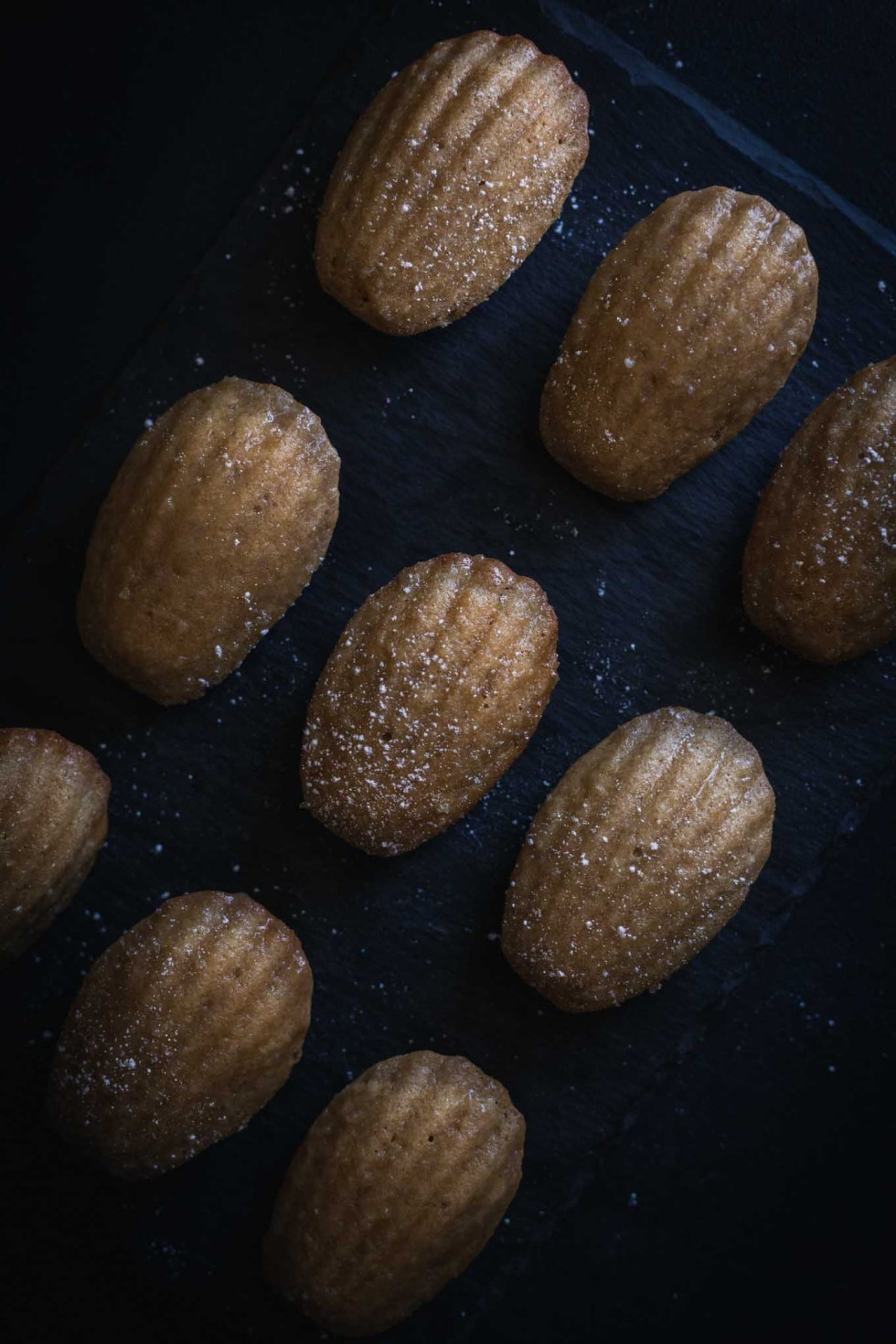 An easy madeleine recipe with a sweet maple glaze! These french butter cakes are light and perfect for sharing!