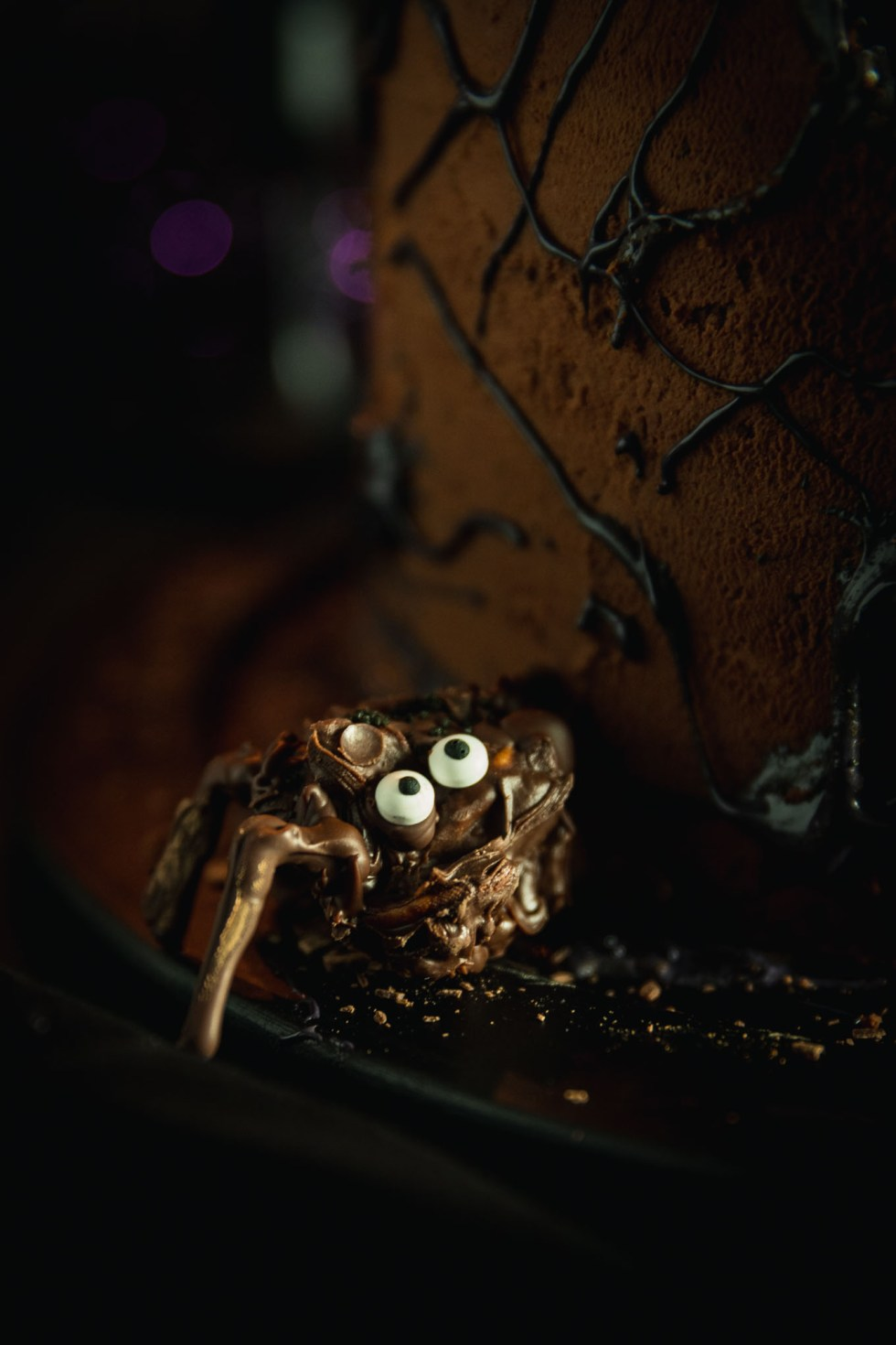 Chocolate spider bite with eyeball sprinkles and piped chocolate legs