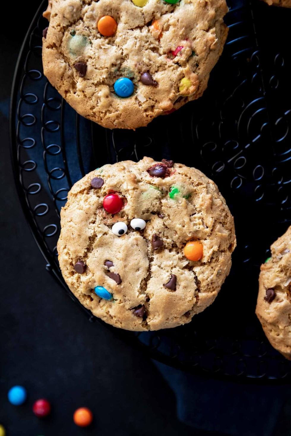 A monster cookie up close with sprinkle eyes