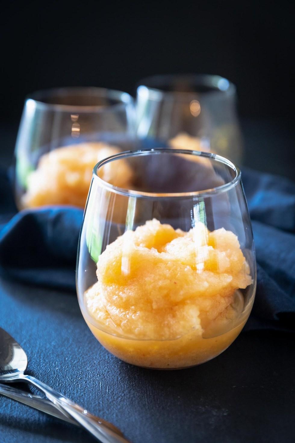 Wine glass containing frozen peach slushie