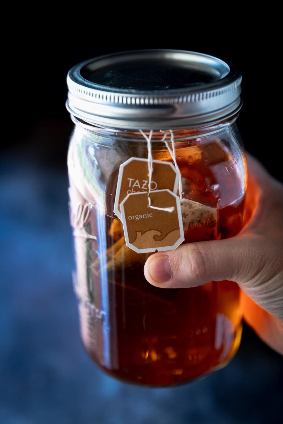 Large mason jar of chai sun tea