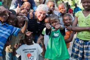 Wyoming philanthropist Foster Friess joins kids from Haiti during a trip to the country following the 2010 earthquake there. (courtesy fosterfriess.com —click to enlarge)