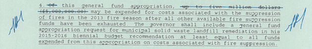 Gov. Mead crossed out and initialed a section of the budget bill relating to fire funding. His action provides a total of $60 million in emergency fire funding for this summer. (Courtesy office of Gov. Mead.)