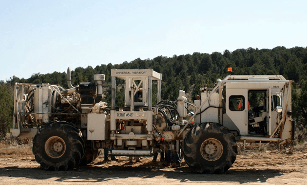 A thumper truck similar to those used in seismic surveys in southeastern Wyoming uses a vibrating plate in the center of the vehicle to send shock waves into the earth, creating a 3D map of subsurface geology that helps drillers find oil and gas. (photo © Maitri Erwin — click to enlarge)