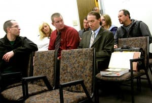 Crooks' supporters in court. Crooks in red shirt flanked by his girlfriend, Tori Watts, and his lawyer, Scott Stinson.