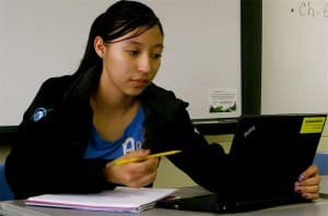 Loveeda White, 16, a sophomore, checks her grades on the computer during study hall at Wyoming Indian High School.