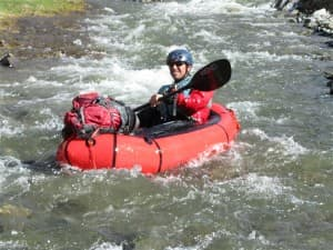 Forrest McCarthy runs the upper Greybull River in a packraft. (Photo courtesy Thomas Turiano)