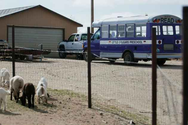 The mobile preschool pulls up to the door of each family's home. But Michelle Carr, the teacher, does not go inside. Families come to the bus, which remains a neutral territory. Families leave home to visit the classroom, even if it is only yards away instead of miles. (Sean Ryan/WyoFile — click to expand)