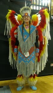 Keegan Her Many Horses in his dance regalia. He is a junior at Wyoming Indian High School, where he competes in cross country, basketball and track.