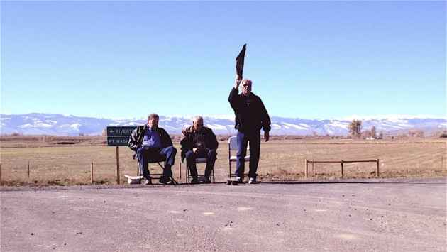 From left to right, John Smith, Nelson White and Leonard Moss lead the cedaring ceremony, a prayer to bless the new road.  (WyoFile/Ron Feemster — click to enlarge)