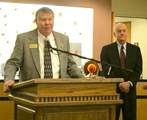 Board of trustees president Dave Bostrom speaks at a press conference as acting university president looks on. (WyoFile/Gregory Nickerson — click to enlarge)