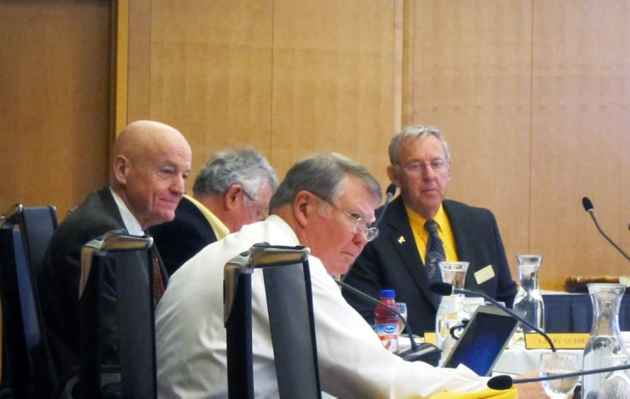 Acting president Dick McGinity sits next to trustees president Dave Bostrom at a board of trustees meeting on November 15, 2013. (WyoFile/Gregory Nickerson — click to enlarge)