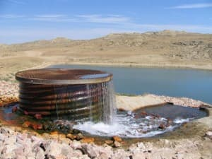 This water was produced from coal-bed methane gas wells, and diverted to a holding pond near the Powder River. In some areas, the production of coal-bed methane gas has substantially drained the coal aquifer because operators had to pump large volumes of water from the coal to get the methane gas also contained there to flow to the surface. By 2010, the industry had pumped 783,092 acre feet of water from the coals, according to the Wyoming State Geological Survey. That's enough water to fill Lake DeSmet three times. Only a small percentage of that water was put to beneficial use. (Dustin Bleizeffer/WyoFile — click to enlarge)