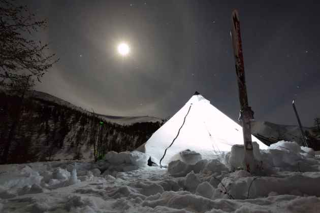 A moon hangs over a winter camp in Mongolia. The backcountry film festival, making its way to different Wyoming towns, celebrates human-powered winter recreation.  (Photo courtesy Jim Harris).